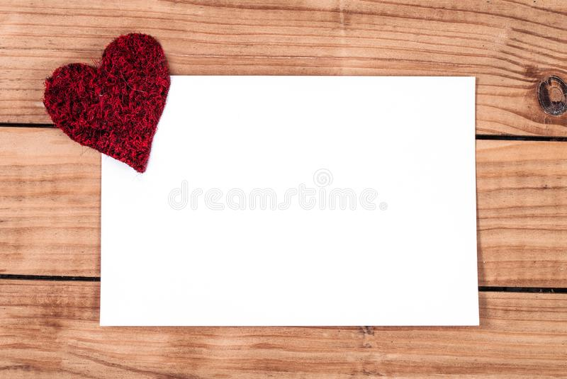 wooden valentine frame and heart with blank piece of paper stock