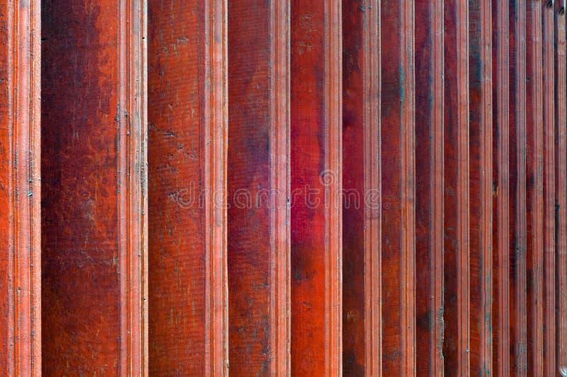 Wooden veranda railing. Closeup of red brown wooden veranda railing for background royalty free stock photography