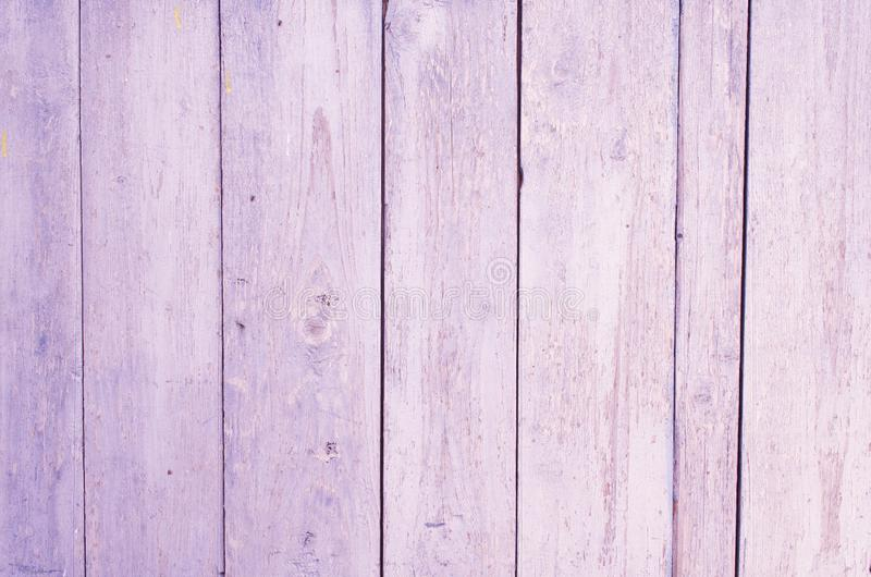 Wooden vertical boards painted in lilac color. lilac wooden background stock photo