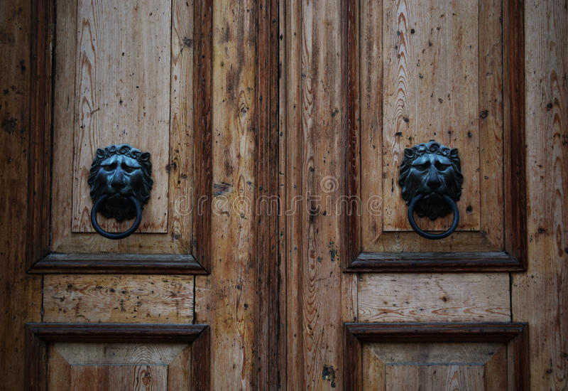 Wooden Vintage Brown Door Lion Knocks. Wooden Vintage Brown old Door Lion Knocks stock photo