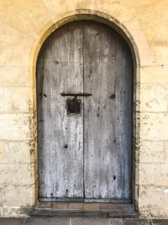 Wooden vintage doors in wall of an old building royalty free stock images