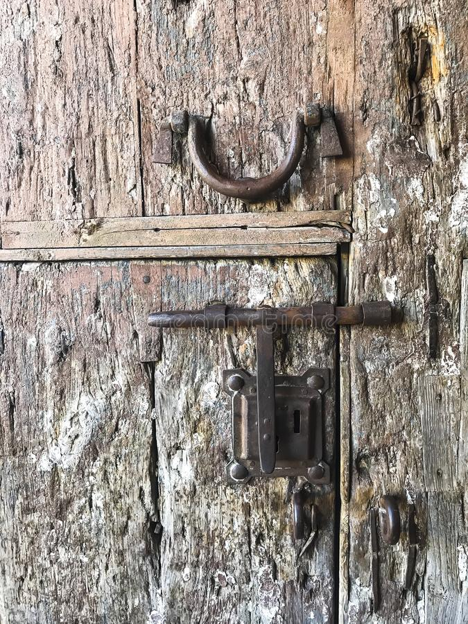 Wooden vintage doors in wall of an old building stock photography
