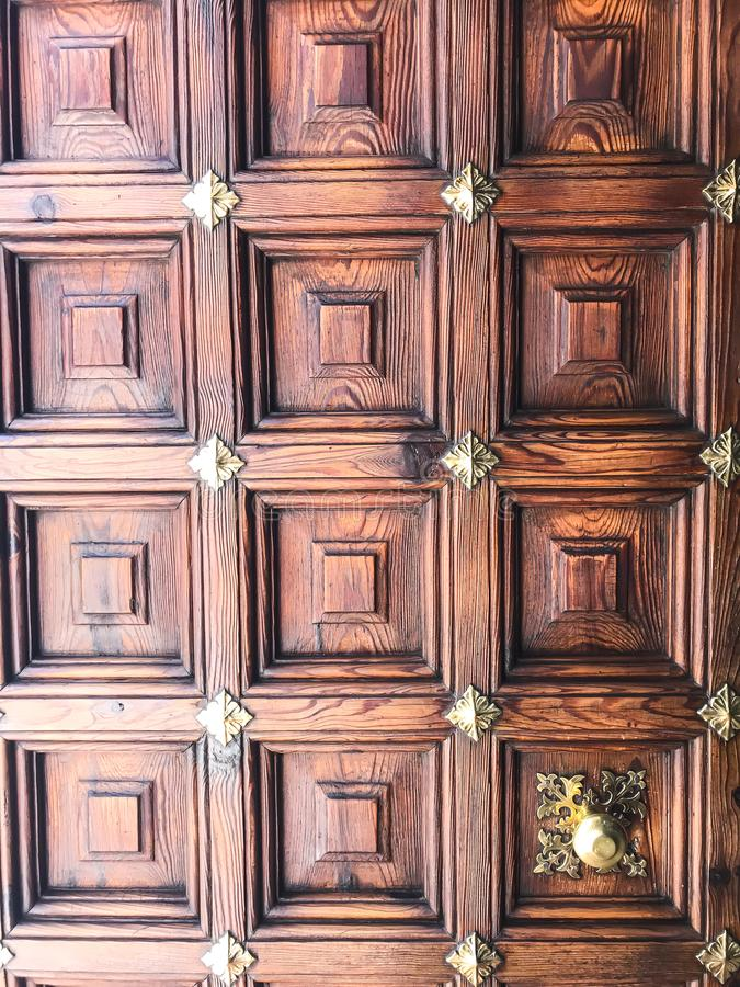 Wooden vintage doors in wall of an old building stock photos
