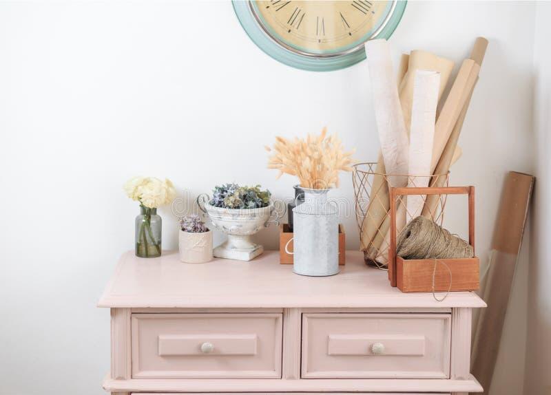 Wooden vintage pink Dresser. Decoration in flower shop. royalty free stock photos