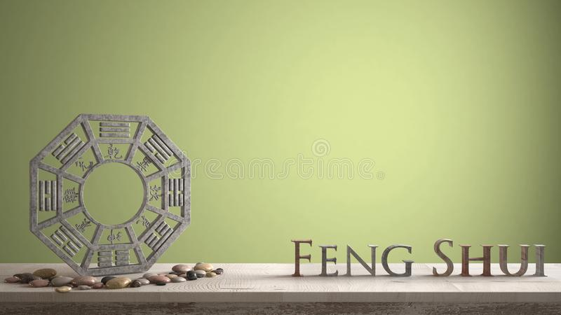 Wooden vintage table shelf with ba gua and 3d letters making the word feng shui with yellow green background with copy space, zen. Concept interior design royalty free stock photo