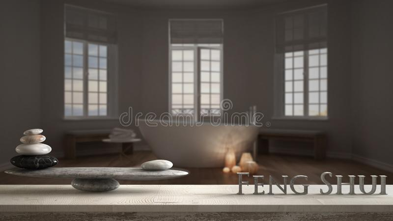 Wooden vintage table shelf with stone balance and 3d letters making the word feng shui over hotel spa bathroom with bathtub, night stock photography