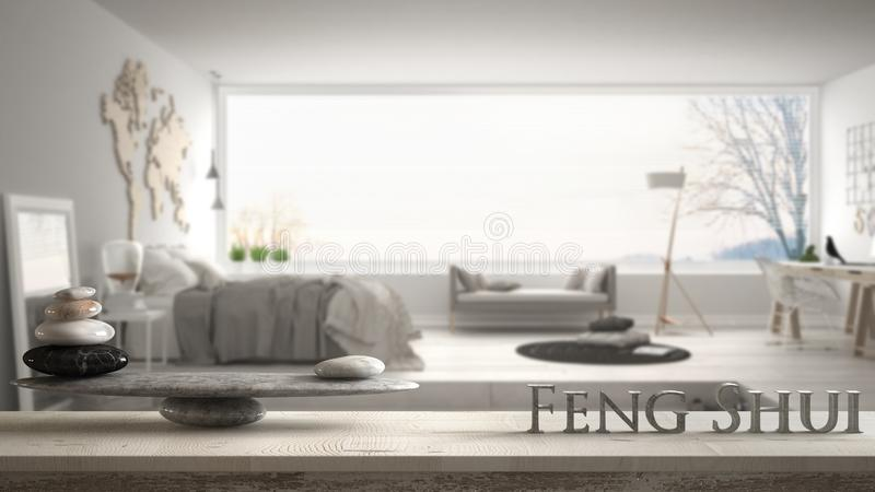 Wooden vintage table shelf with stone balance and 3d letters making the word feng shui over trendy bedroom with big panoramic wind stock images