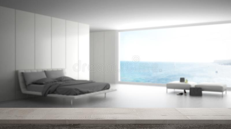 Wooden vintage table top or shelf closeup, zen mood, over blurred minimalist bedroom with big window on sea panorama, white archit. Ecture interior design stock photos