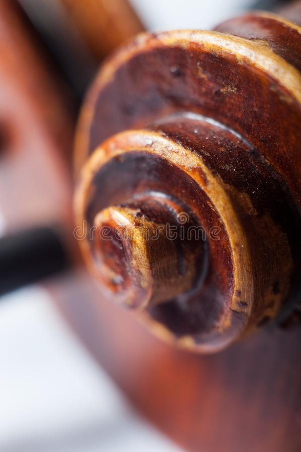 Wooden violin scroll royalty free stock photography
