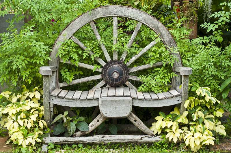 Wooden wagon wheel chair. stock photography