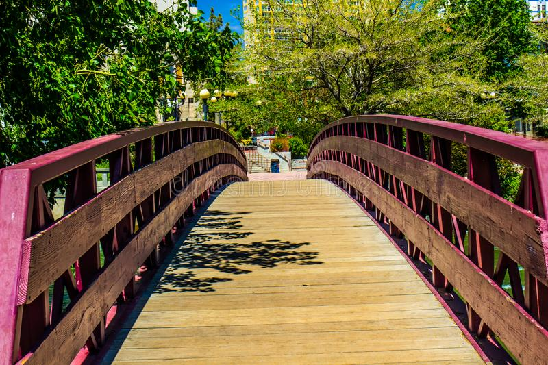 Wooden Walking Bridge Over River Leading To Downtown Area. Wooden Walking Bridge With Handrails Leading To Downtown Area In Reno, Nevada stock photos