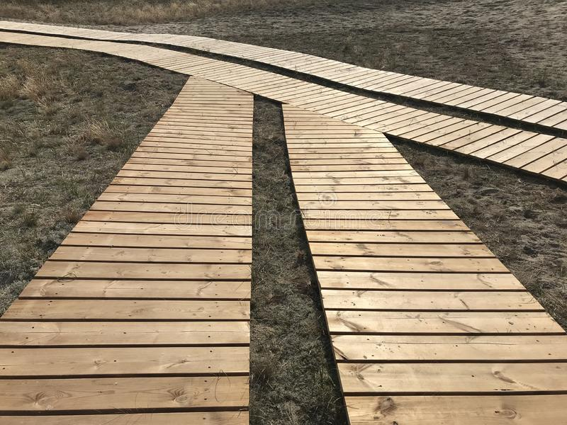 Wooden walking path to the sandy beach.  royalty free stock image