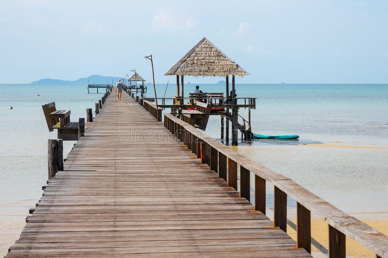 Wooden walkway bridge with seats that lead to the sea in summer in Koh Mak Island at Trat, Thailand stock photography