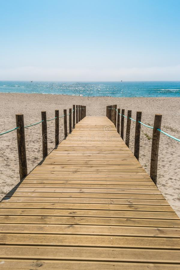 Wooden walkway over the sand dunes to the beach. Beach pathway i. N Praia de Paramos, Espinho, Portugal stock photo