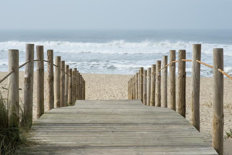 Wooden walkway to access the beach of Esmoriz in Portugal.  stock photo