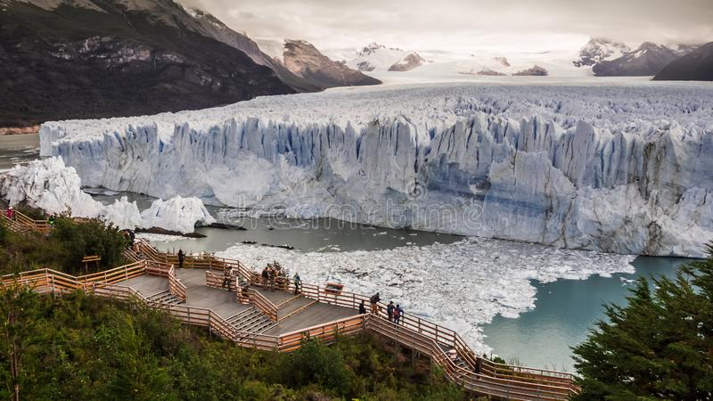 Wooden walkways in front of the ice wall of the Perito Moreno glacier in the Glacier National Park stock image