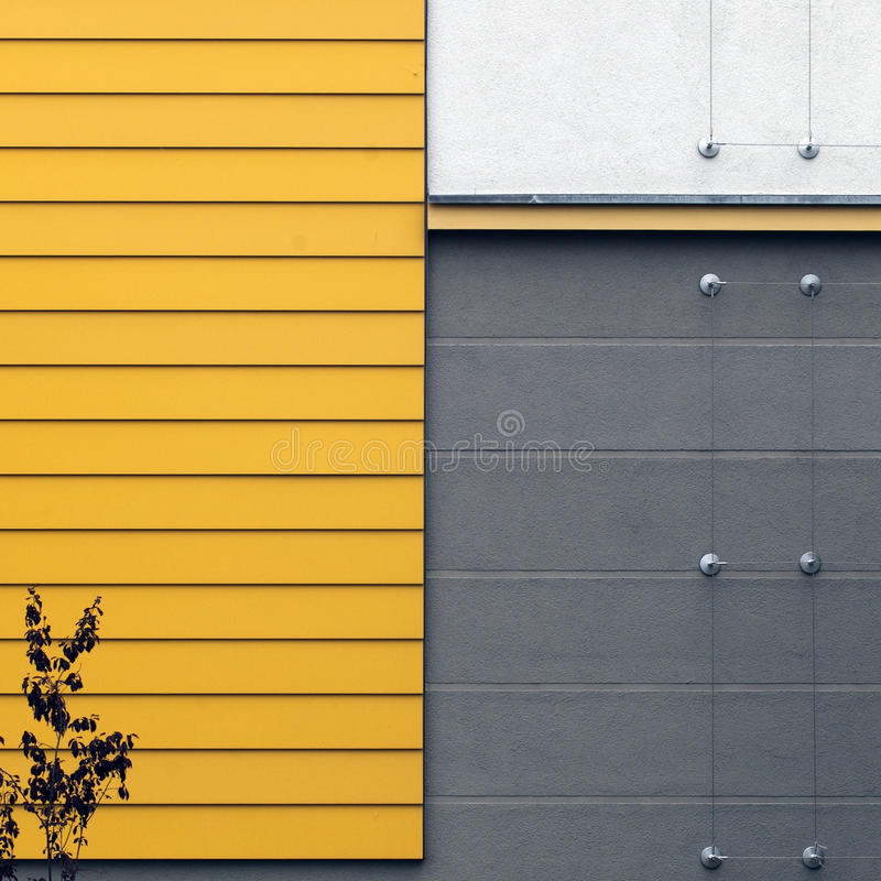 Wooden wall. Section of a yellow and grey wall royalty free stock image