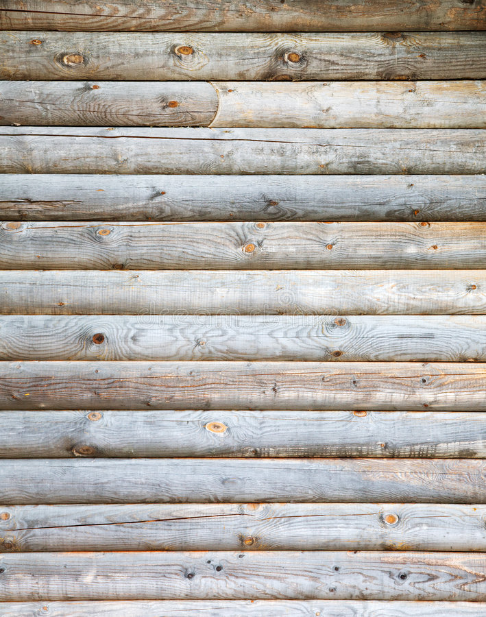 Wooden wall. Old-fashion rural wall from wooden logs royalty free stock images