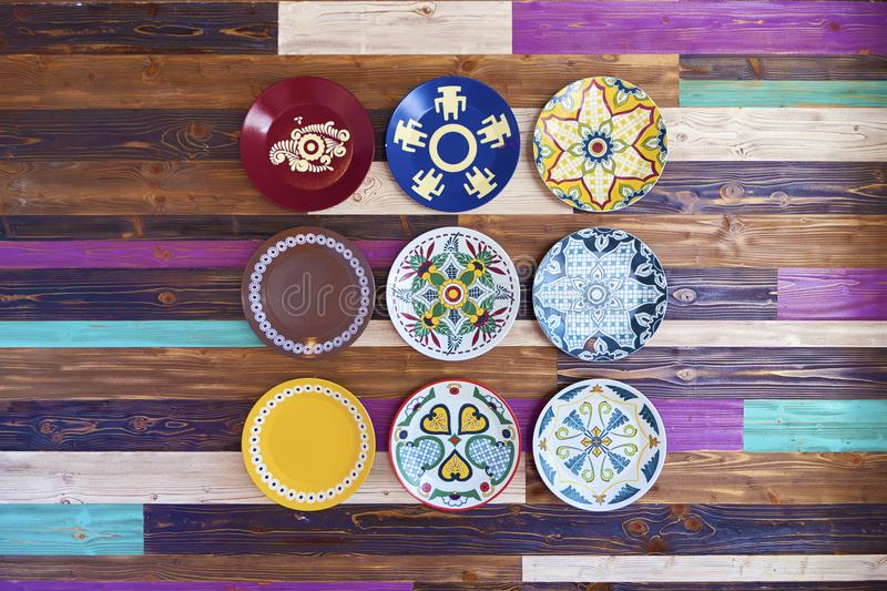 Wooden wall with colorful plates stock image
