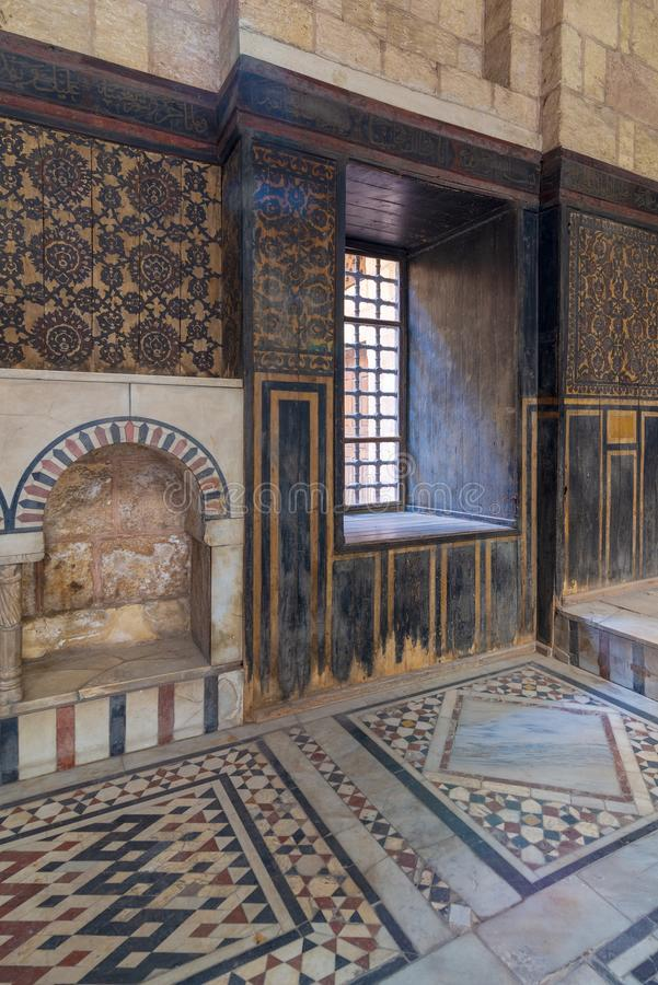 Ottoman historic house of Moustafa Gaafar, Darb Al Asfar District, Cairo, Egypt with decorated wooden wall and marble floor royalty free stock photo
