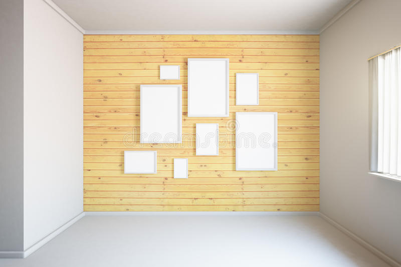 Wooden wall with frames. Wooden wall with blank frames in empty room interior. Mock up, 3D Render royalty free illustration