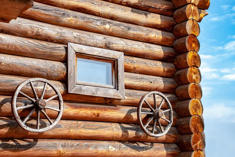 Wooden wall of a log house stock photo