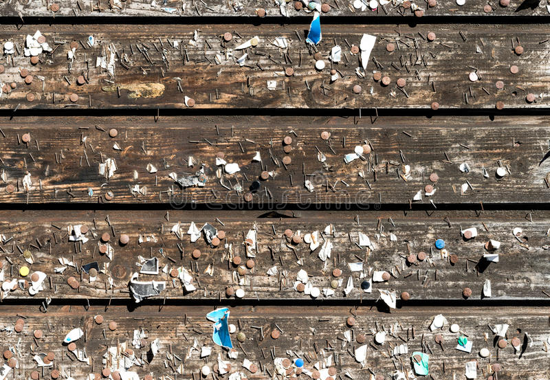 Wooden wall with old pins and staples. Vintage bulletin board. stock photos