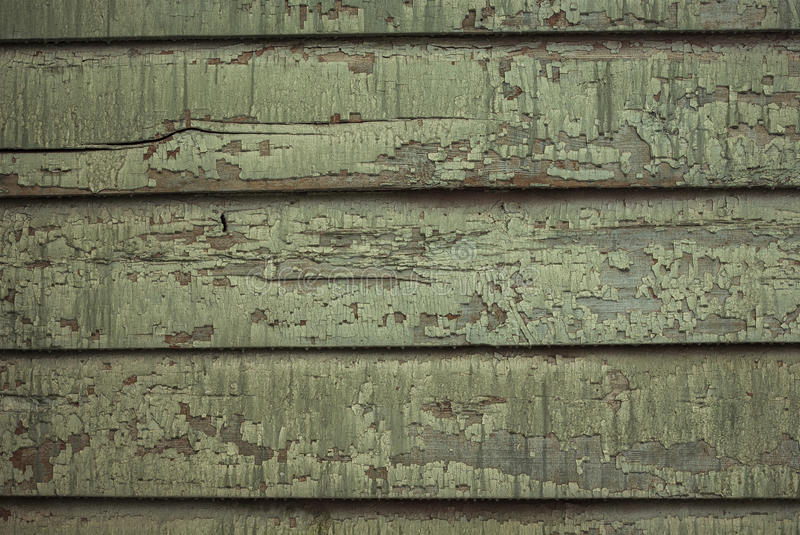 Wooden wall with paint is severely weathered and peeling. Old wooden wall with paint is severely weathered and peeling. Wooden texture, wood background with old stock images