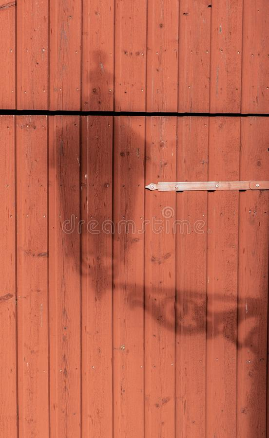 Wooden wall is painted with red paint. The texture of the old wood. royalty free stock image