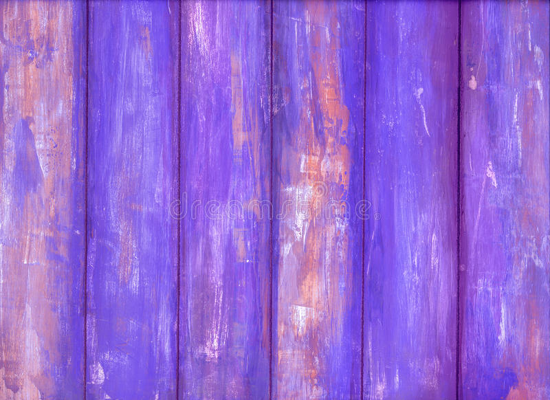 Wooden wall with violet peeling paint. Violet peeling paint wooden background texture stock images