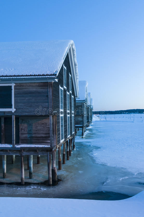 Wooden warehouses cold winter evening Hudiksvall royalty free stock photos
