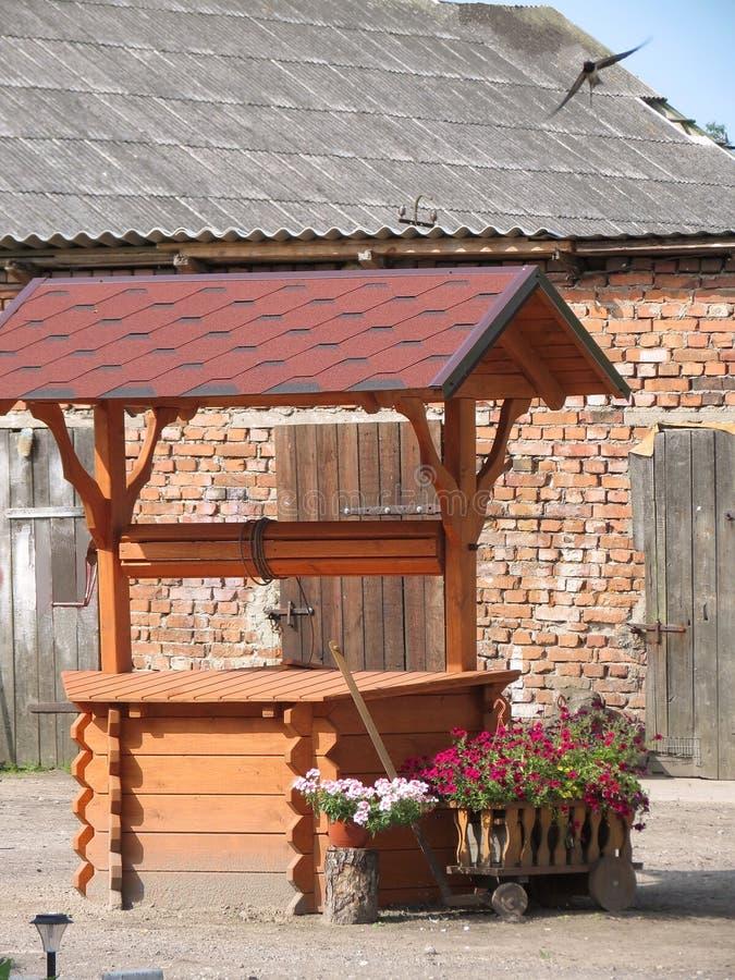 Download Wooden well stock photo. Image of door, flower, wooden - 26322304