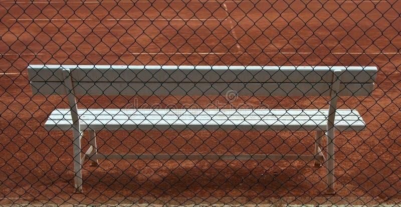 Wooden white seat on tennis court