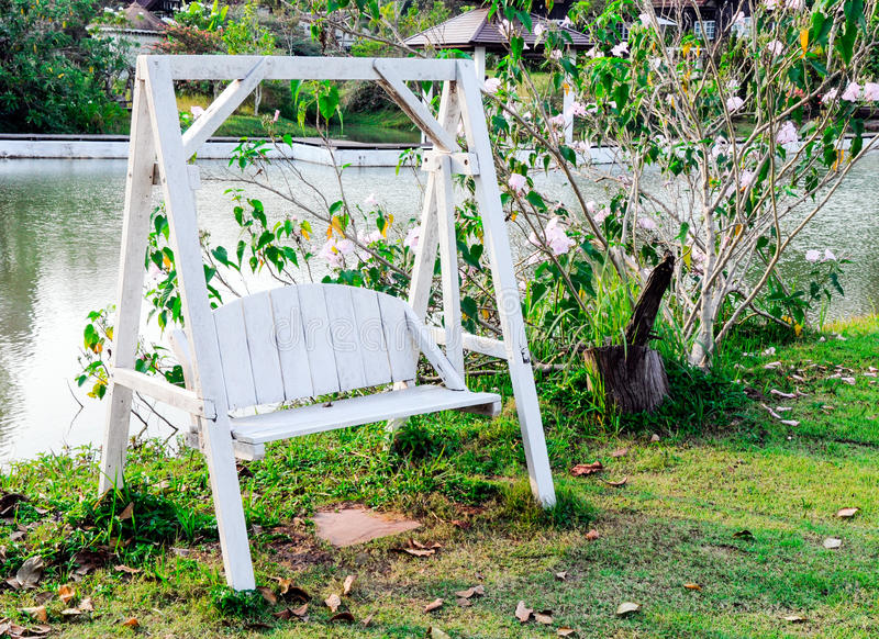 Wooden white swing stock photography