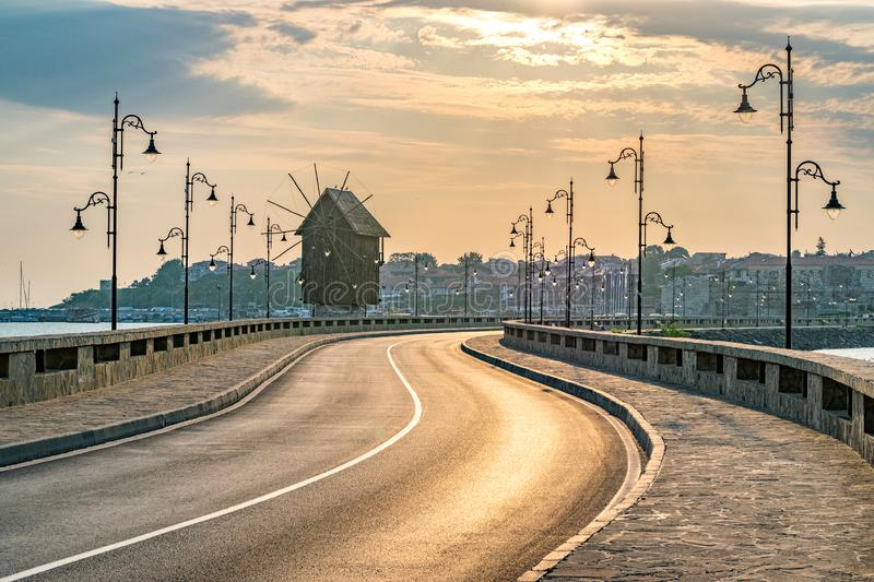 The wooden windmill on the isthmus at sunrise in Nessebar ancient city on the Bulgarian Black Sea Coast. Nesebar or Nesebr is a stock photos