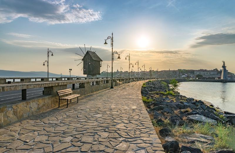 The wooden windmill on the isthmus at sunrise in Nessebar ancient city on the Bulgarian Black Sea Coast. Nesebar or Nesebr is a stock images
