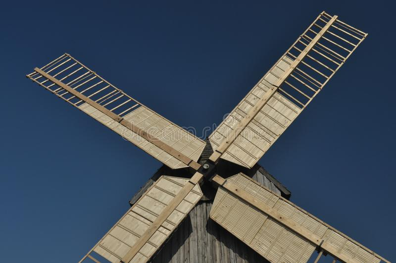 Wooden windmill. Monument. Antique mill powered by the wind.  royalty free stock photo