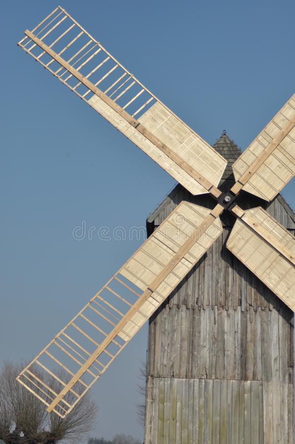Wooden windmill. Monument. Antique mill powered by the wind.  stock photo