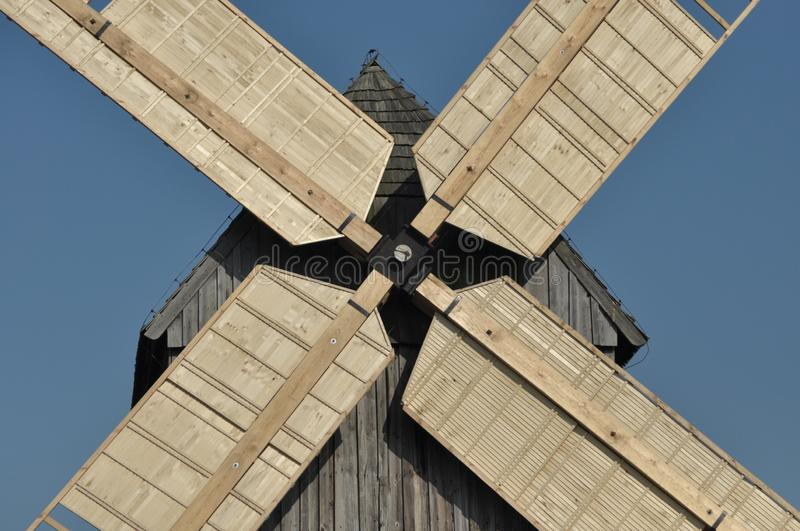 Wooden windmill. Monument. Antique mill powered by the wind.  stock photography
