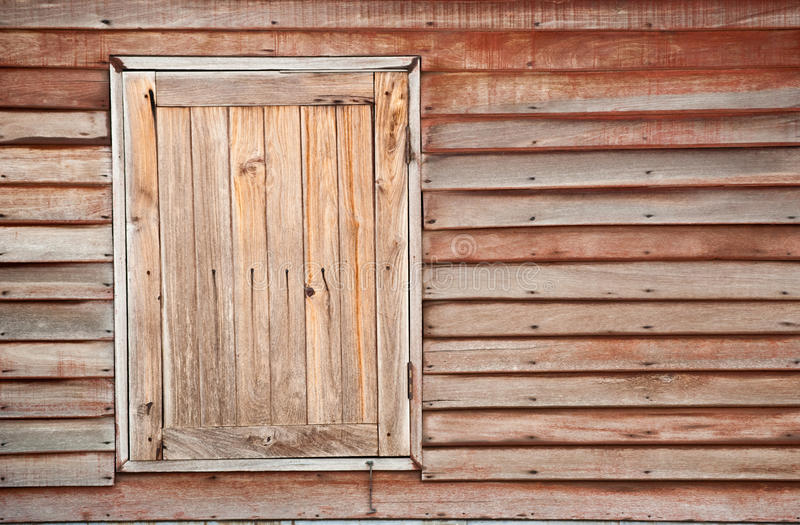 Wooden window. Old wooden house wall and closed window royalty free stock photography
