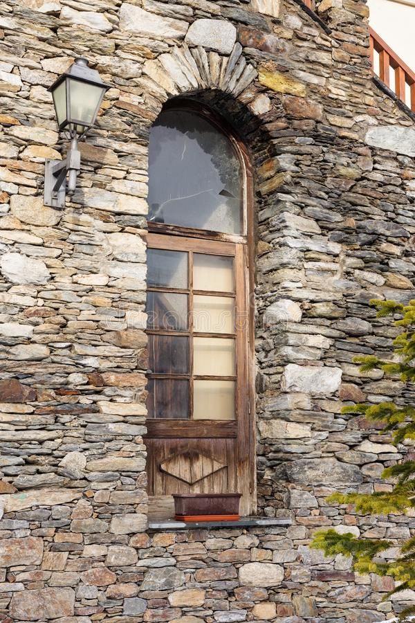 Wooden window in the ancient stone house stock photos