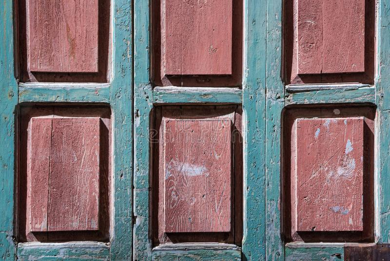 Wooden window background with pink rectangles and emerald blue slats royalty free stock photo