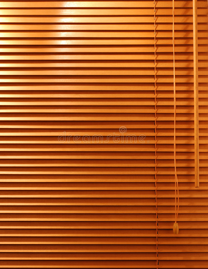 Wooden Window Blind. A home interior Venetian blind with wooden slats stock images