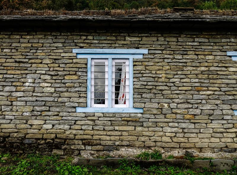 Wooden window with brick wall of rural house royalty free stock images