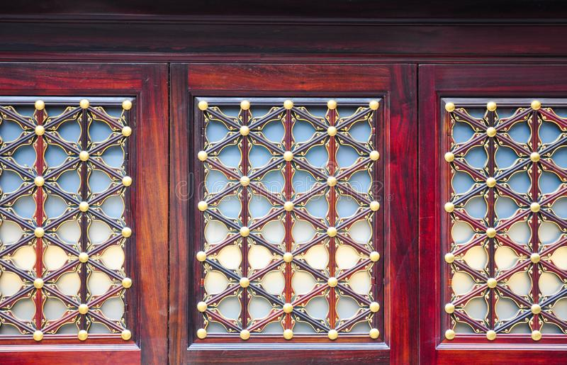 Wooden window colorful pattern of Chinese traditional architecture, in red royalty free stock image