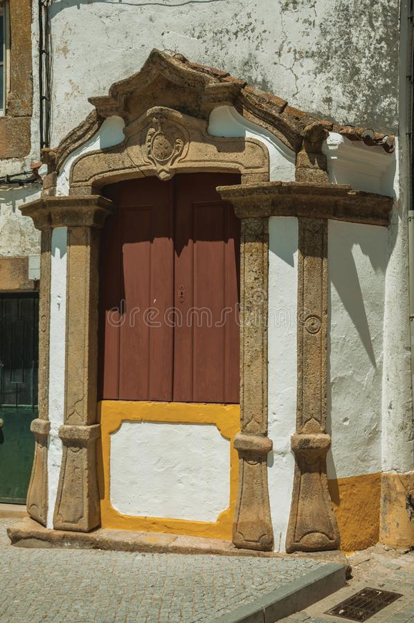 Wooden window on facade of old colorful house. And exquisite stone decoration at Castelo de Vide. Nice little town with medieval castle to ensure the defense of royalty free stock images