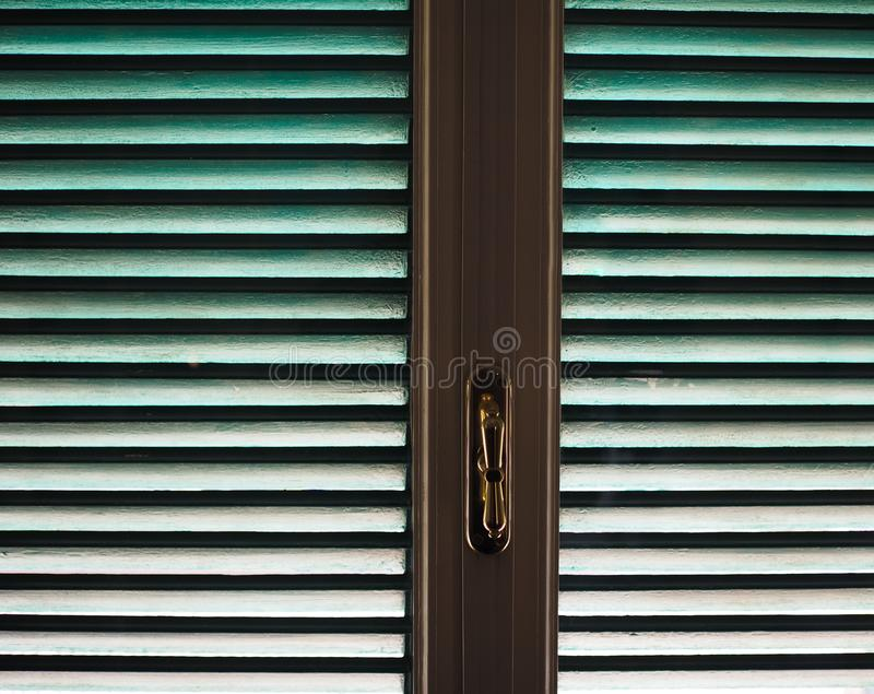 Window with shutters. Wooden window frame with green blinds shutters royalty free stock photography