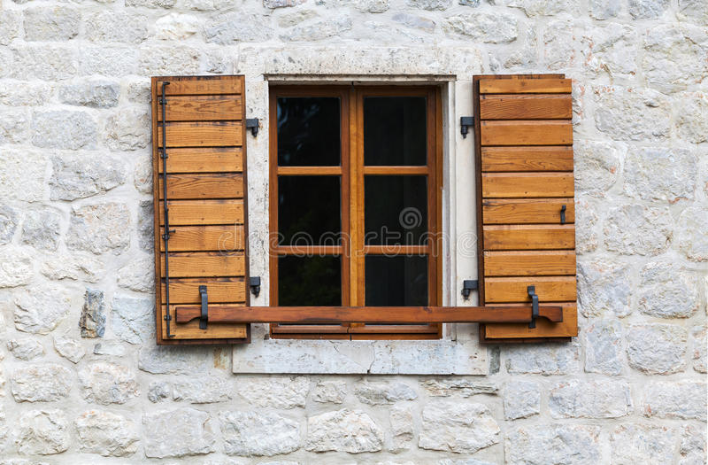 Wooden window with open jalousies stock images