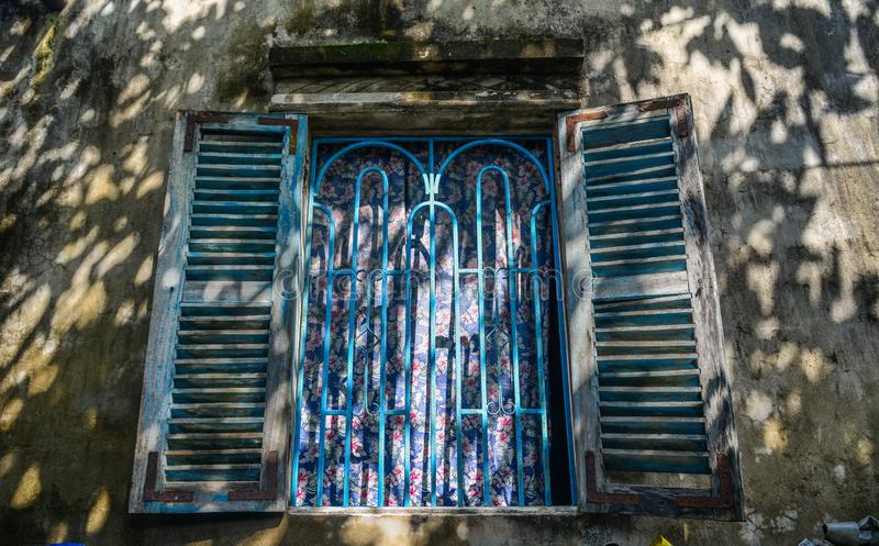 Wooden window of a rural house in Vietnam stock photography