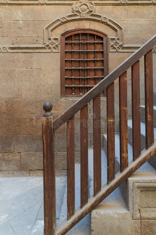 Wooden window and staircase with wooden balustrade leading to historic building, Old Cairo, Egypt. Wooden window and staircase with wooden balustrade leading to stock images